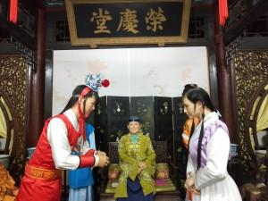 Jia Baoyu meets Lin Daiyu under Granny Jia's jovial gaze.